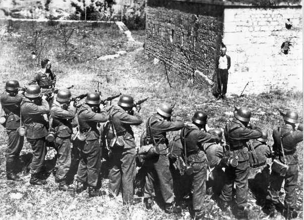 Georges Blind smiles as he faces a German firing squad